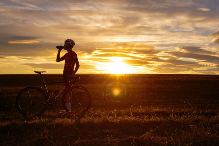 Cyclist in front of sunset