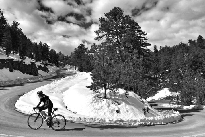 cyclist climbs Flagstaff Mountain in the snow
