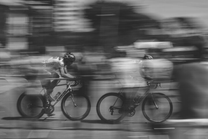 two cyclists streak past
