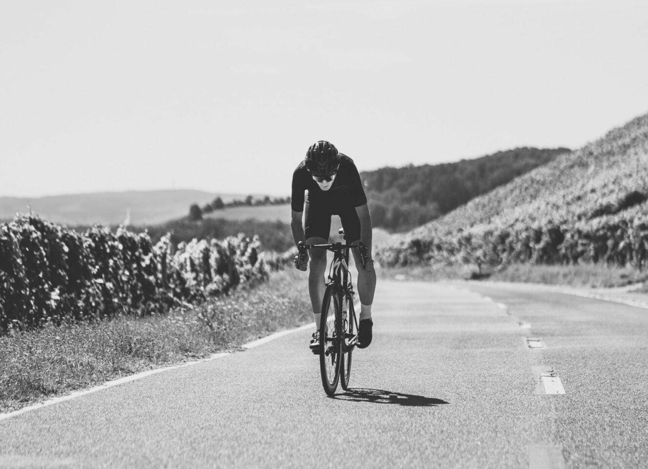 Lone cyclist training on empty road
