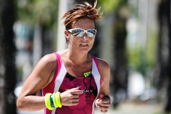 triathlete runs in the heat